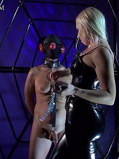Blond masked, gagged and blindfolded a guy and now is attaching a whole bunch of clams and weights to his nipples and all over the cock