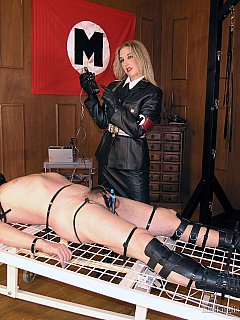 Evil military bitch is having male captive stretched on the rack and ready for cock electrification interrogation session