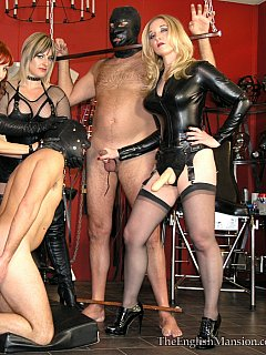 Bitchy wives are having a femdom session where they are educating their hubbies with strap-on toys and then make suck each other dicks