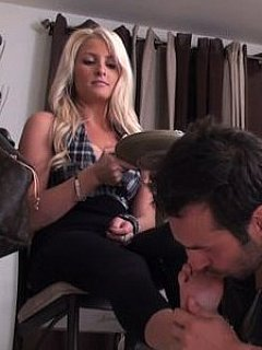 Gorgeous blond is dipping her bare feet into the food letting petboy to eat is straight from her toes