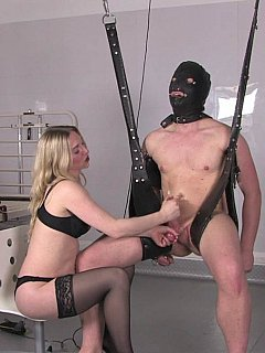 Slave is having his chastity tube removed and his cock stroked in reward for giving dominatrix a perfect pussy lick