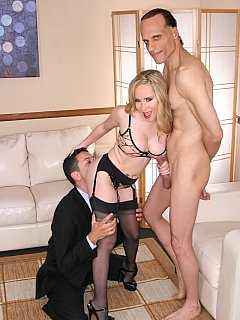 The cuckolding session is going well as bitchy blond wife gags her man with her feet while lover in holding her tight while she stroking his cock