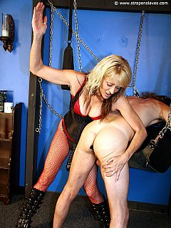 Putting naked man in chains and spanking him is the warm up. The main event in pushing big dildo into his ass