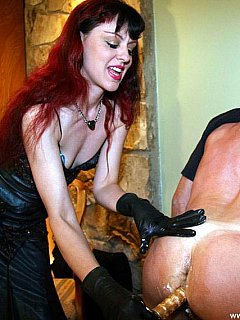 Classy redhead is wearing gloves when doing horrible things to slave and his ass. Touching him with her bare hands is disgusting