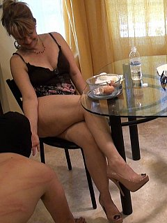 Naughty bitches are having fun when sing their feet and legs to serve food for the petboy in training