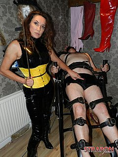 Experienced femdom lady is managing three male slaves in the BDSM dungeon