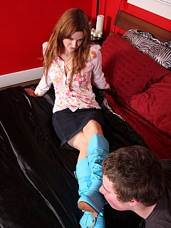 Redhead is wearing boots of unusual color in the scene where male sub licks them from top to bottom