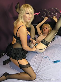 Blond mistress is doing a good job of educating a foot-worship and anal strap-on sissy slave